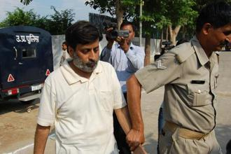 The Allahabad high court verdict ends a nine-year ordeal of the parents who were found guilty by a CBI court of murdering 14-year-old Aarushi in a fit of rage because they suspected her of having an affair with Hemraj. Above, a file image of Rajesh Talwar being taken into custody. Photo: Hindustan Times