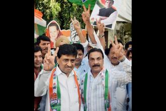 Maharashtra Congress chief Ashok Chavan (left) and party workers celebrate the party's win in the Nanded municipal elections. Photo: PTI