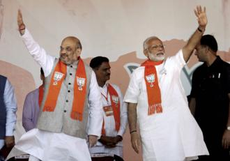 Prime Minister Narendra Modi with BJP president Amit Shah during the BJP rally in Gandhinagar on Monday. Photo: PTI