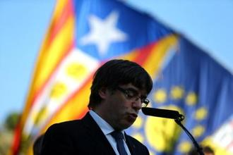 "Catalan President Carles Puigdemont delivers a speech at the memorial of ""Fossar de la Pedrera"" (Pedrera mass grave) in Barcelona, Spain, on Sunday. Photo: Reuters"