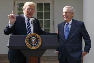 US President Donald Trump and Mitch McConnell speak to reporters in the Rose Garden of the White House after their meeting on Monday. Photo: AP