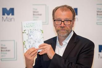 George Saunders poses with his book Lincoln in the Bardo during a photocall at the Royal Festival Hall in London on 16 October. Photo: AFP