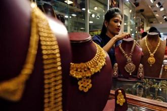 Pure gold (99.9% purity) also went down by a similar margin to finish at Rs29,765 per 10 grams as against Rs30,010 previously in Mumbai. Photo: Reuters