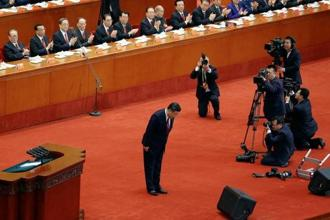Chinese president Xi Jinping bows before delivering his speech during the opening session of the 19th National Congress of the Communist Party of China at the Great Hall of the People in Beijing on Wednesday. Photo: Reuters
