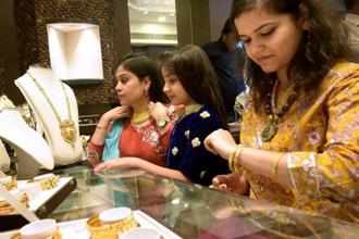 Pure gold (99.9 purity) also dipped by a similar margin in Mumbai to finish at Rs29,645 per 10 grams as compared to Rs29,765 on Tuesday. Photo: PTI
