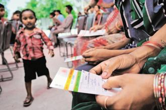 Earlier in the day, the Reserve Bank of India (RBI) said linkage of biometric identity number Aadhaar with bank accounts is mandatory. Photo: Priyanka Parashar/Mint