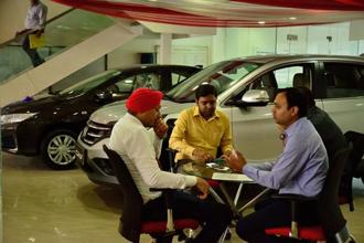 Auto firms may have to reduce inventory in the months ahead. Photo: Pradeep Gaur/Mint