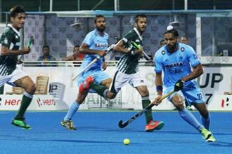 Players of India and Pakistan in action during their match at the 10th men's Asia Cup hockey tournament in Dhaka on 15 October. Photo: PTI