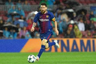 Barcelona's forward Lionel Messi runs with the ball during the UEFA Champions League match against Olympiacos FC at the Camp Nou stadium on 18 October. Photo: AFP