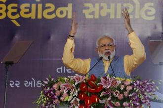 PM Narendra Modi address a gathering during the inauguration function of a ferry service in Bhavnagar on Sunday. Photo: AP