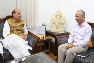 Home minister Rajnath Singh (left) and former Intelligence Bureau (IB) director Dineshwar Sharma in Delhi on Monday. Photo: PIB