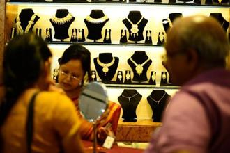 Pure gold (99.9 purity) also came down by a similar margin to close at Rs29,555 per 10 grams from Rs29,721 in Mumbai. Photo: Pradeep Gaur/Mint