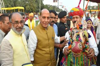 Union home minister Rajnath Singh with MoS for tourism, KJ Alphons meeting artists during the inaugural ceremony of 'Paryatan Parv–Grand Finale' on the Rajpath Lawns in New Delhi on Monday. Photo: PTI