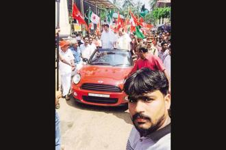 A Facebook post by BJP leader K. Surendran shows CPM's Kodiyeri Balakrishnan (right) riding the Mini Cooper during a rally. Photo: Facebook