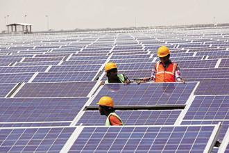 Backed by low financing costs and falling module prices, India's solar power tariff fell to a record Rs2.44 per kilowatt hour (kWh) in May before firming up to Rs2.65 per kWh in an auction by the Gujarat government last month. Photo: Mint