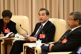 Chinese foreign minister Wang Yi (centre). Photo: AFP
