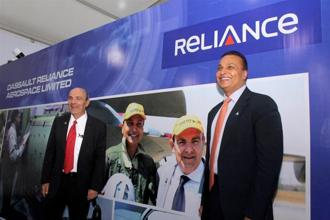 Reliance Group chairman Anil Ambani and Dassault Aviation chairman & CEO Eric Trappier lay the foundation stone for Dhirubhai Ambani Aerospace Park in Nagpur on Friday. Photo: PTI