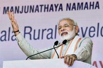 Prime Minister Narendra Modi at a public meeting for the launch of various programme at Ujire in Karnataka on Sunday. Photo: PTI