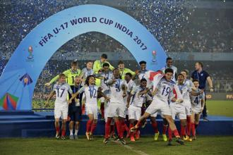 England's team celebrate during the presentation ceremony after winning the Fifa U-17 World Cup trophy in Kolkata on Saturday. Photo: AP