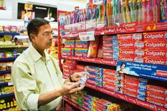 Businesses can separately show the GST component and the MRP of the product while uploading the invoice on GSTN, filing returns and paying taxes. Photo: Bloomberg