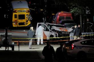 Police investigate a pick-up truck used in an attack on the West Side Highway in Manhattan, New York on Wednesday. Reuters