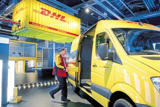 DHL plans to launch the new business unit early next year and is in the process of building a team and fleet of trucks. Photo: Bloomberg