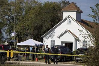 Law enforcement officials investigate a mass shooting at the First Baptist Church in Sutherland Springs, Texas, on Sunday. Reuters