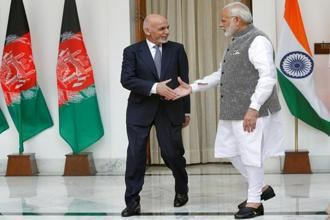 Afghanistan's President Ashraf Ghani shakes hands with India's Prime Minister Narendra Modi at Hyderabad House in New Delhi, on 24 October 2017. Photo: Reuters