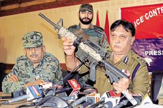 Muneer Khan, IGP of Kashmir range, shows a US-made M4 assault rifle recovered from militants after a gunbattle, in Srinagar on Tuesday. Photo: PTI