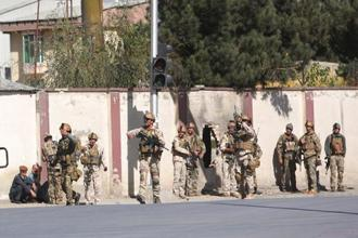 Afghan security personnel arrive at 'Shamshad TV' building after an attack in Kabul, Afghanistan, on Tuesday. Photo: AP
