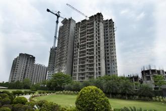 Buying under-construction properties attracts 12% GST, while GST is not applicable on completed projects with occupancy certificates. Photo: Ramesh Pathania/Mint