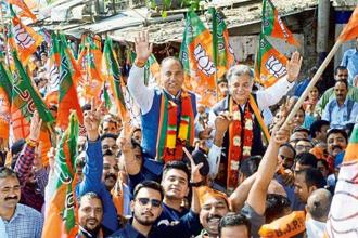 Former union minister Sukh Ram's son Anil Sharma (right) with BJP leader Jai Ram during a nomination filing procession for Assembly elections, in Mandi. Photo: PTI
