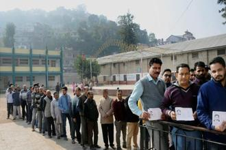 Voters outside a polling booth in Mandi, Himachal Pradesh, on Thursday. Photo: PTI