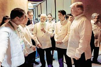 Prime Minister Narendra Modi (centre) with US President Donald Trump (left), Japanese PM Shinzo Abe (2nd from left) and other world leaders at an Asean Summit dinner in Manila on Sunday. Photo: PTI