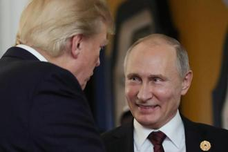 US President Donald Trump chats with Russia's President Vladimir Putin as they attend the APEC Economic Leaders' Meeting in the central Vietnamese city of Danang on Saturday. Photo: AFP
