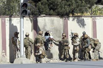 Afghan security personnel rescue a man from the Shamshad TV compound after an attack in Kabul last week. Photo: PTI