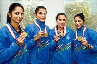 (From left) Navjot Kaur, Savita Punia, Rani Rampal and Navneet Kaur posing with their Asia Cup medals in Delhi last week. Photo: HT