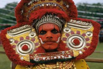 In the ongoing season, Theyyam performances are decked with red flags and CPM banners.