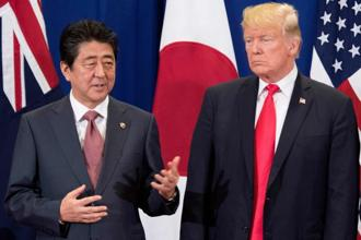 Japan Prime Minister Shinzo Abe and US President Donald Trump interact during the latter's trip to Asia. Photo: AP