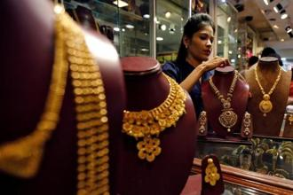 In New Delhi, gold of 99.9% and 99.5% purity went down by Rs75 each to Rs30,450 and Rs30,300 per 10 grams, respectively. Photo: Reuters
