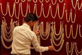 Pure gold (99.9 purity) also moved up by a similar margin to end at Rs29,610 per 10 grams against Rs29,595 earlier. Photo: Reuters