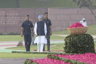 Former Indian Prime Minister Manmohan Singh arrives to pay tributes to former Prime Minister Indira Gandhi at her memorial on her birth anniversary in New Delhi on Sunday. Photo: PTI