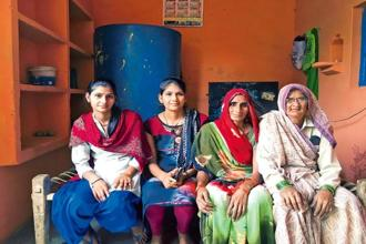 Wrestler-turned-Internet Saathi Neetu Bhagour (second from left) with her family in Khaula village, Uttar Pradesh. Photographs: Sunny Sen.