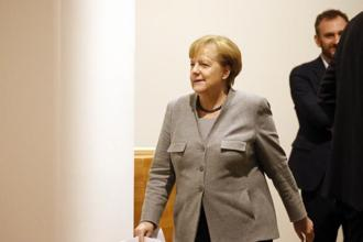 After 12 years in office that have made her Europe's anchor of stability in times of crisis, Angela Merkel said she's staying on as acting chancellor and will consult with Germany's president later Monday on what comes next. Photo: Reuters