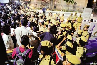 Police and mediapersons outside late Tamil Nadu CM J. Jayalalithaa's residence at Poes Garden in Chennai on Friday night. Photo: PTI