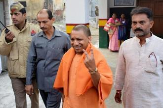 Uttar Pradesh CM Yogi Adityanath flashes victory sign after casting his vote for the local bodies elections in Gorakhpur on Wednesday. Polling for the other two phases will be held on 26 November and 29 November, while counting of votes for all the three phases would be done on 1 December. Photo: PTI