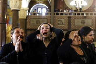 Women during the funeral for those killed in a Palm Sunday church attack in Alexandria, Egypt, in April this year. Photo: AP