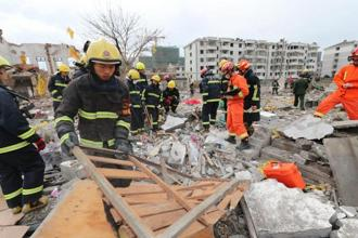 Rescue workers search at the site of an explosion in Ningbo, China's eastern Zhejiang province. Photo: AFP