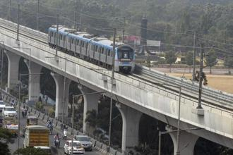 A metro train runs on an elevated railway line during a trial run undertaken ahead of the opening of the Hyderabad Metro Rail on 24 November 2017. Photo: AFP