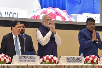 PM Narendra Modi (centre) with Chief Justice of India Dipak Misra (left) and law minister Ravi Shankar Prasad at valedictory session of the National Law Day in New Delhi on Sunday. Photo: PTI